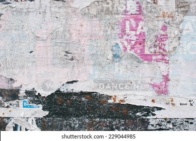 Abstract paper collage of faded anonymous billboard posters