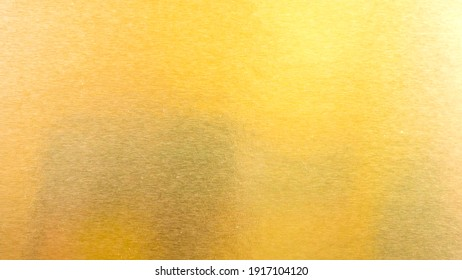 Abstract paper golden for Merry Christmas and Happy new year. Gradation gold foil leaf shiny with sparkle yellow metallic texture background. top view.