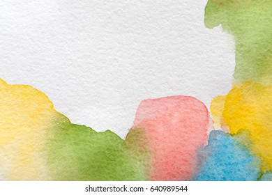 Abstract pastel watercolor spots painted texture background. Colors on white with copy space