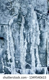 An abstract pattern formed from water seeping through a concrete wall at Fort Casey on Whidbey Island in Washington State.