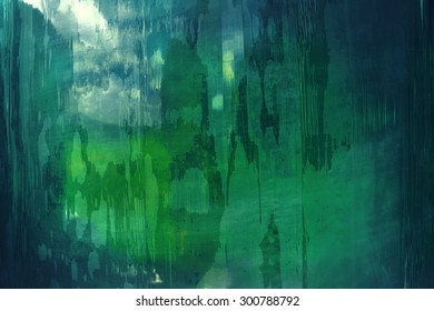 Abstract pattern in green and blue, taken on a plastic tarpaulin in closeup