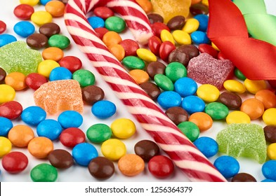 Abstract pattern with round color candy on background. Colorful sweets top view. Flat lay image
