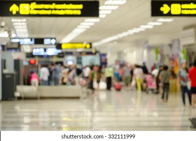 Abstract people walking  at International Airport blurred background with bokeh in Terminal Departure Check-in.
