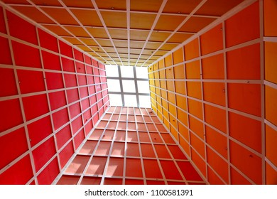 Abstract perspective photograph of vertical lobby ceiling with skylight and strong geometry and symmetry and dramatic colors as background