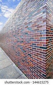 Abstract perspective of tall brick wall ending in infinity. Close up