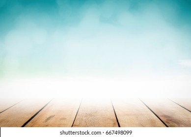 Abstract perspective wooden table top view on blur grocery background concept for product mock up pub floor on blue nature beach. Christmas lunch breakfast wallpaper in summer pastel teal turquoise.