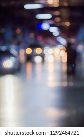 Abstract photo blurred of colorful Light at parking area.
