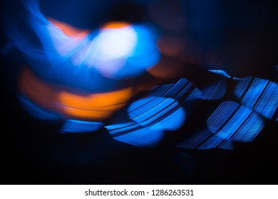 Abstract photo of blurred light sources in orange and blue colors