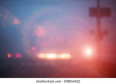Abstract photo of blurred street lights in evening