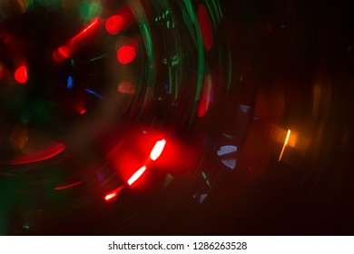 Abstract photo of blurry light sources of different colors twisted into a circle