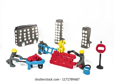 Abstract photo of buildings works. Figures made from Play Clay. Isolated on white background.