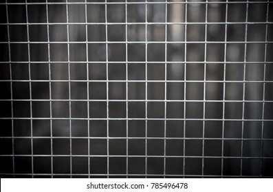 abstract photo of iron bars from jail or fence