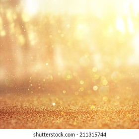 abstract photo of light burst among trees and glitter bokeh. image is blurred