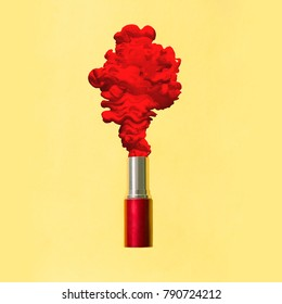 Abstract photo of lipstick with red smoke on yellow background. Beauty concept.