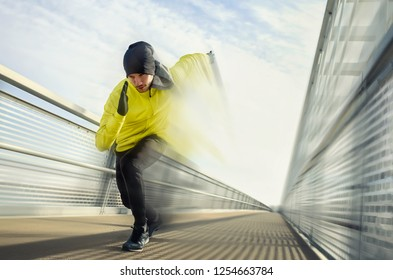 Abstract photo of man running along bridge. Exercising, Jogging, Sport, speed. Male athlete running fast.