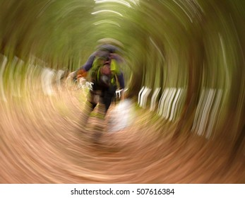 abstract Photo out of focus roundabout. man with backpack in forest. Can be used as background