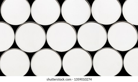 Abstract photo of top view of white fuel drums. Useful graphic resource