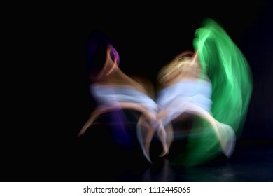 Abstract photo of two dancers showing motion blur