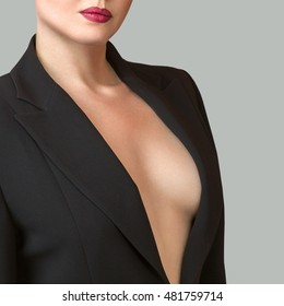 Abstract photo of young woman in formal suit with decollete