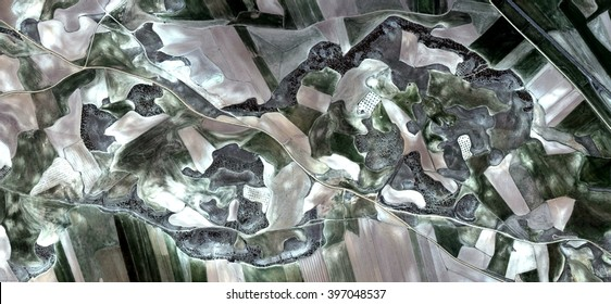 abstract photography of the Spain fields from the air, bird's eye view, tribute to Pollock, artistic representation of human labor camps, abstract expressionism, contemporary art,optical illusions,