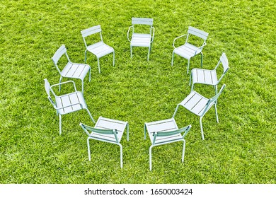 abstract picnic on grass circle of grey garden stools landscape from above against green lawn background. Aerial top down view of circle seating area with  seats for relax. City park rest zone