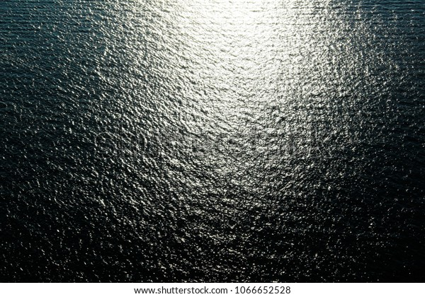 Abstract picture of a calm Ocean, Water with waves in the Sun, Abstract Art