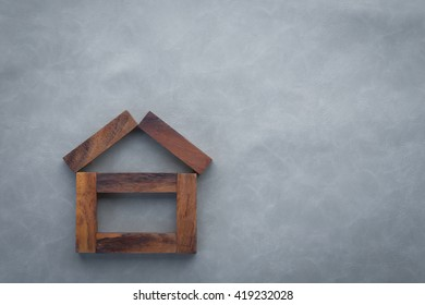 abstract picture of a house built from rectangle wooden pieces