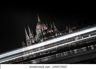 An abstract picture of the Hungarian Parliamentwith the lights of teh cars