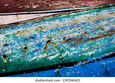 Abstract picture of paint on a row boat; colourful wood with texture