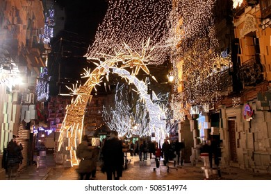 abstract picture of the street of the city of Toledo, Spain, Castilla La Mancha, expressionism, abstract photograph of Christmas decorations in the Plaza de Zocodover
