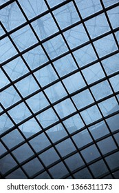Abstract picture.Grid above the dome.Round in the square. .Deep blue color.Gasometers Vienna inside