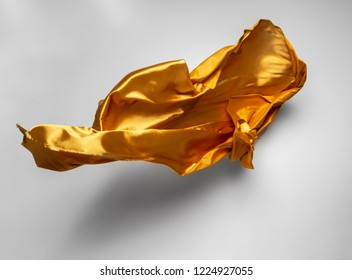abstract piece of yellow fabric flying, high-speed studio shot