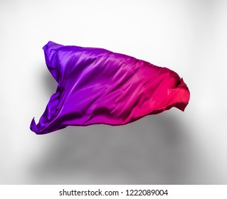 abstract pieces of multicolored fabric flying, high-speed studio shot