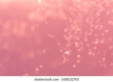 Abstract Pink bokeh defocus glitter blur background.