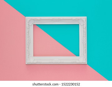 Abstract pink and mint green paper minimal background with white frame. Minimal diagonal composition with empty picture frame.