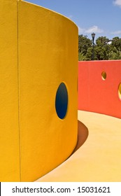Abstract playground featuring bright primary colors and circles.