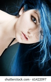 An abstract portrait of a young woman with electric blue hair and eyes.