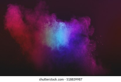 abstract powder splatted background. Powder explosion on black background. Colored cloud. Colorful dust explode.