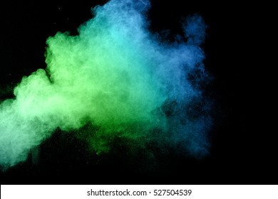abstract powder splatted background,Freeze motion of color powder exploding,throwing color powder, multi color glitter texture on background.