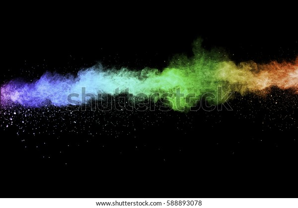 abstract powder splatted on black background,Freeze motion of color powder exploding or throwing color powder, multicolored glitter texture.