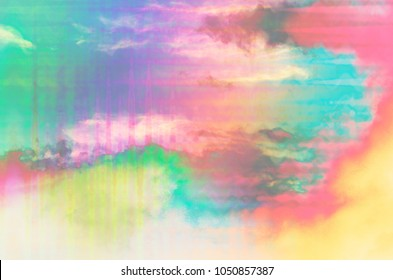 An abstract psychedelic rainbow colored cloudy sky.