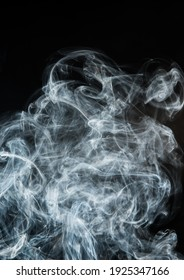 Abstract puffs of smoke on a black background.