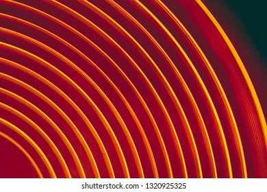 Abstract radiating waves underneath grill pan