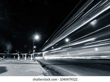 Abstract of Rajpath in city lights, New Delhi, India, Asia. Night photography on freeway of Rajpath. It is the road that connects the famous India Gate and Rashtrapati Bhavan.