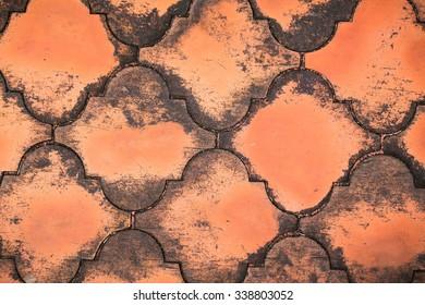 abstract rectangular orange brick paving stones in a public ground