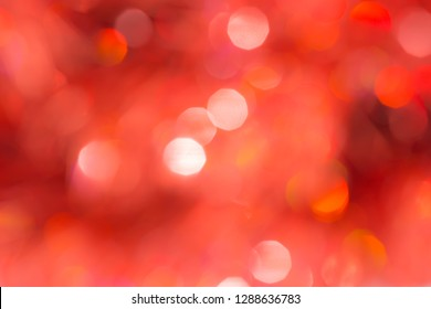 Abstract red and black defocused circular facula. Bokeh blurred color light can use background