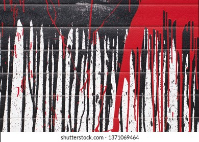 Abstract red and black paint drips on a white background