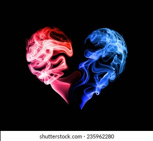 Abstract red and blue heart of the smoke on a dark background.