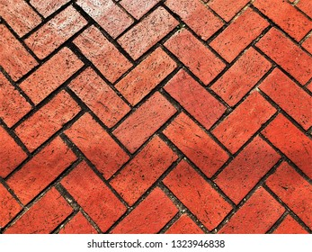 Abstract red brickwork floor of the pathway with crossing design background texture , Georgia USA.