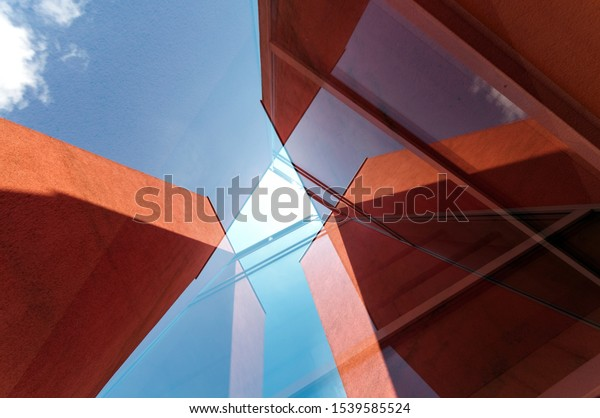 Abstract red building blue sky